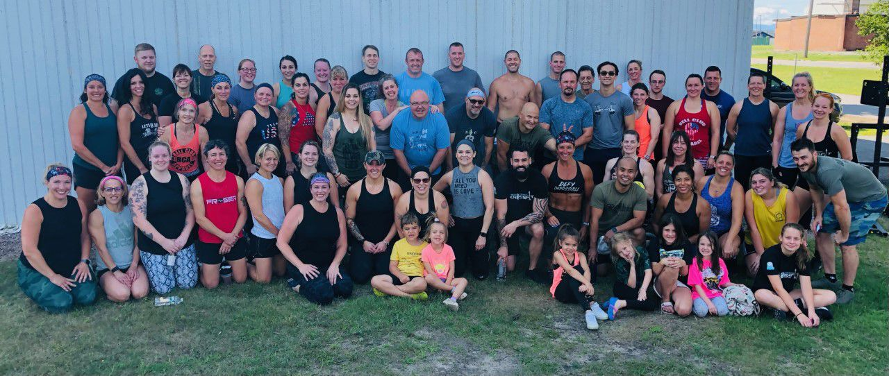 Dozens of Cross Fit athletes participated in the fundraiser to offset the cost of Flannigan's surgery